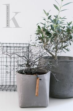 concrete pots | caisa K * The Oohh Pots, paper dipped in rubber and sand. http://www.cranfields.com/content/ooh-pot-extra-large*** An optional DIY by dipping old shopping bags in concrete with a bucket inside to keep the shape. OR try Burlapcrete, which is basically loose-weave burlap, soaked in a modified rapid setting cement. Here instructions how to make regular concrete flower pots: http://www.wikihow.com/Make-Concrete-Flower-Pots.