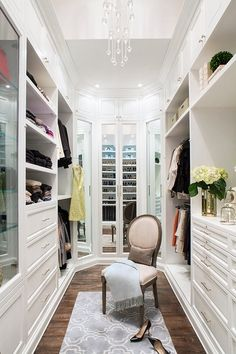 A beautiful and stylish walk in wardrobe with all clothes Organised and neat