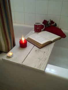 I need to make one of these (not that I would ever get a chance to use it and there would probably be bath toys on it rather than a candle, but still, cool idea)!