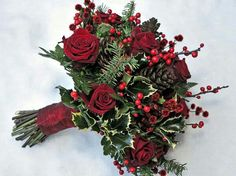 Winter Holiday Wedding Bouquet: Red Roses, Red Berries, Red Waxflower, Pine Cones, Evergreen Foliage, Holly