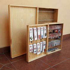 """Earring display in front of its """"big brother"""". Wooden display in front of the big one - still work in progress. Fold 'n go speaks for itself!"""