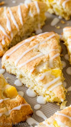 Tropical Mango Scones filled with orange zest, juicy mangoes, and topped with tropical fruit glaze!