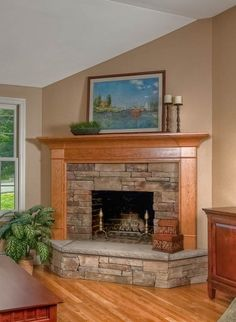stack stone fireplace with wooden mantle/surround
