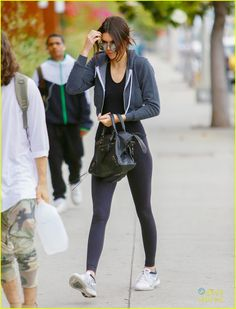 Kendall Jenner wears her workout clothes while stopping by a sushi restaurant to grab lunch with her friends