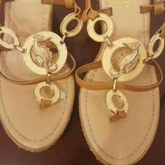 Wedge sandals a free ring with those shoes Cream with seahorses Buckle straps in the back. The sea horse Ring matches the shoes it's a stretchy cream color with that and seahorse. Free gift with purchase Shoes Platforms
