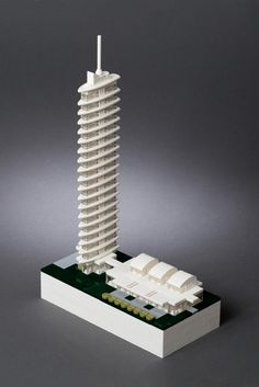 An overhead view that helps to clarify that main floor layout. There is a driveway and main entrance on the upper left side of the model. This leads to the lobby of the tower, which then allows access to the single-story section at the back.  You can also see the sun-screens, terraces, and hedge at the lower right area. Break-out spaces.  Here, it finally depicts how the surfboards define the individual floors of the tower--and the overall skyline 'profile' of the building. Plus, you'd have…