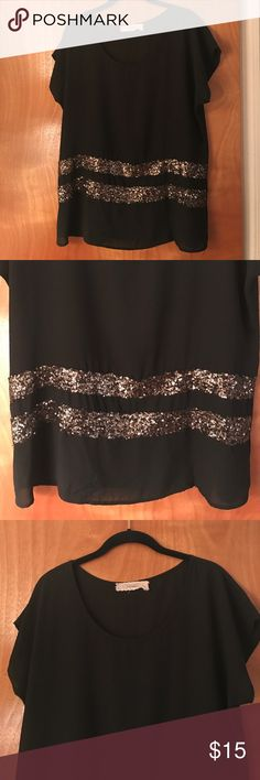 Fun Black and Gold Blouse! Black blouse with gold, sparks detail at bottom. Very cute and can really dress up an outfit. Worn only a few times! Tops Blouses