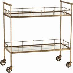 2-tiered storage cart in vintage brass finish with antique mirror glass shelves and casters for mobility. SKU AR-1289 Manufacturer Arteriors Categories Bar Carts, Kitchen & Dining Furniture, Furniture