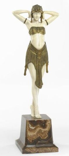 Chiparus Demeter - Scarabee, circa 1928. gilt-bronze and carved ivory and with a marble base