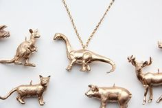 These vintage animal toys have been repurposed into adorable charms! Description from etsy.com. I searched for this on bing.com/images