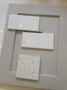 """Cabinets - Shaker-style by Integrity in """"fog"""" painted finish Backsplash- White porcelain subway tiles with taupe grout Countertops- Iced white man-made quartz by MSI"""