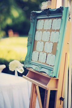 Love this idea!  Framed cork board seating chart for wedding guests!