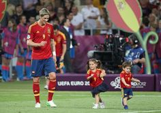 Sergio Busquets, Fernando Torres and Jordi Alba play during the Spain vs Italy final match during the Euro 2012 in Kiev, Ukraine