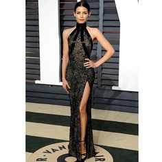 For her second look, for the @vanityfair #oscar party,@jennaldewan selected to wear #zuhairmurad 's slim fitting high slit race back gown with high collar in sheer lace with black bugle bead detailing from the #fall2014 #hautecouture collection