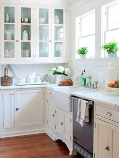 white cabinets, hardware, no toe kick, marble backsplash, painted cabinets