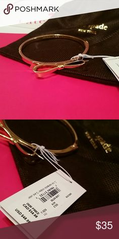 Kate Spad Bow Bangle NWT Gold bow, side clasp, comes with travel bag for the bracelet kate spade Jewelry Bracelets