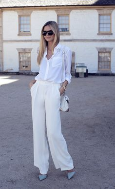 white wide leg pant, white shirt, blue pumps