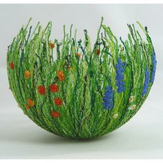 Cottage Garden Bowl; bet this could be made with easter grass, small silk flowers and white glue over a balloon...What do you think?