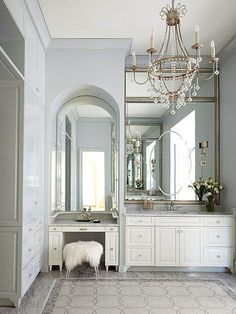 Teaming pale blue with white is a no-brainer; the duo packs a pleasing punch in this master bathroom. A bit of silver and marble mosaic floor tiles bring an adult sensibility to what could otherwise be an overly sweet pastel scheme. Bathroom Color Schemes, Bathroom Colors, Bathroom Designs, Bathroom Chandelier, Interior And Exterior, Interior Design, Bath Remodel, Beautiful Bathrooms, Bathroom Inspiration