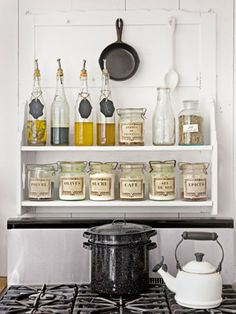 Kitchen Vignette  - I love old jars and bottles for ingredient storage in the kitchen, and these labels with French are so stylish.