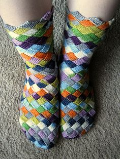 "One of three ""Lonely Socks"". The three socks are made with a total of 460 yards (420m) of yarn."