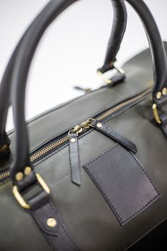 Its all in the Details - Kana all in one Gym Bag in the Black and Olive color. We love this combo!