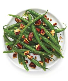 Honey-Mustard Green Beans With Pecans   Can't contemplate Thanksgiving without a green bean side dish to cozy up to your turkey and stuffing? Our archives are full of tasty Thanksgiving green bean recipes that make the most of seasonal ingredients without requiring a ton of time. Of course, a classic green bean casserole—baked with creamy mushrooms and crowned with crunchy onions—is always a crowd pleaser, but sometimes you want to aim a little higher than the stuff from the can.