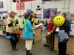 Members of the Pollinator Project Rogue Valley delivering a Halloween card to the store manager at the Lowe's in Medford, OR asking him to deliver the message to Lowe's corporate headquarters that Lowe's need to give bees treats, not tricks.