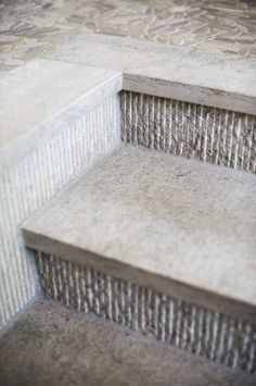 Guido Blue Limestone in a honed and glacier wall finish. This small ribbed effect adds an extra layer of interested to this beautiful steps.