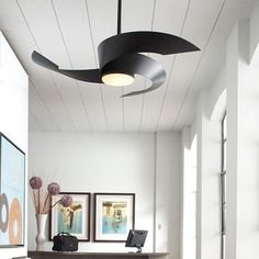 A sleek, modern take on the ceiling fan: the Fanimation Torto is a black beauty that will improve any room - or outdoor space. The damp rated ceiling fan also works in covered exterior locations. Living Room Fans, Fancy Living Rooms, Living Room Ceiling Fan, Home Ceiling, Bedroom Ceiling, Ceiling Lights, Ceiling Decor, Unique Ceiling Fans, Contemporary Ceiling Fans