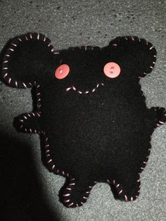 Stuffed felt creature.