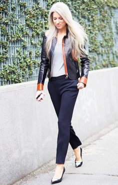 Sarah Harris in a two-tone leather jacket, simple top, and trousers
