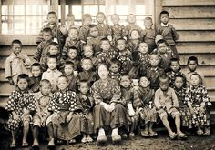 School class with teacher, circa 1920, northern Japan.  Image via Sgt Steiner of Flickr