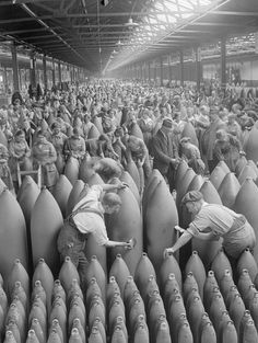 INDUSTRY DURING FIRST WORLD WAR CHILWELL (Q 30036)   Munitions workers paint shells in the National Shell Filling Factory at Chilwell, Nottinghamshire, during the First World War.