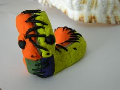 """My Sons' contribution to Day 18 of #30doc @createstuff his tribute to the inspiration """"yellow"""" a frankenstein like version of two snakes sewn together everything is clay even the """"stitching"""""""