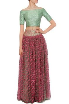A green base net lehenga skirt with hot pink floral thread embroidery all over. It has a green japanese silk under layer. It is paired with a mint green fully sequined off shoulder blouse in lycra with back zip closure. Shop Now at www.carmaonlineshop.com #carma #carmaonlineshop #designer #online #lehenga #embroidery #floral #sequins #net #silk #off-shoulder #VvanibyVaniVats #VaniVats #opulent #romanticism #shopnow