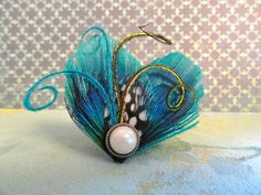 WINTER Heart and Soul Collection - Teal Mini Peacock Clip, Feather Fascinator. $16.50, via Etsy.