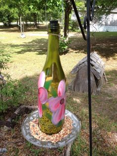 Recycled wine bottle bird feeder. $15.00, via Etsy.