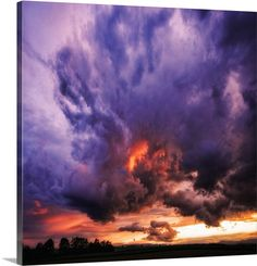 """Photographic shot of a stormy sky with punches of purple and orange - """"The Sky is Broken"""" wall art by Philippe Sainte-Laudy from Great BIG Canvas"""