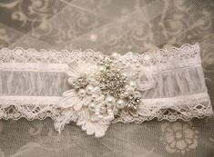 shear wedding garter with lace pearls and by BeSomethingNew, $45.00