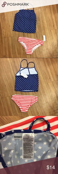 Old Navy Two Piece Tankini Patriotic Stars 10/12 L Old Navy Two Piece Tankini Patriotic Stars and Stripes NEW NWT L 10/12  Super cute girls tankini style swimsuit from Old Navy.  It has a UPF of 40.  Size is large or 10/12.  New with tags.  #starsandstripes #stars #stripes #patriotic #new #nwt #swim #letsgotothebeach #americana #murica #fourthofjuly #july4th #tankini Old Navy Swim Bikinis