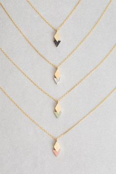 Diamond overlapping triangle stone charm necklace.  This site has cute affordable necklaces