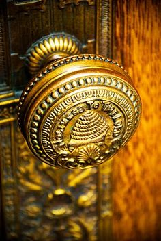 """Holiness to the Lord"" and bee skep on this beautiful door knob embellishing a solid oak door."