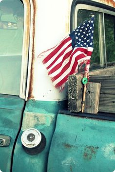 American flag on old truck.
