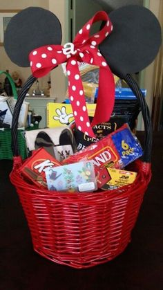 Use black and red spray paint, black craft foam, and red polka dot ribbon to make a Minnie (or Mickey) Easter basket. Great idea!