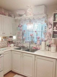 Shabby Chic Kitchen Decor - Personally, I'm not  going with pink, I would choose sage, golden tones and natural colors. Love the cabinets with the  items and the countertops in the same color.
