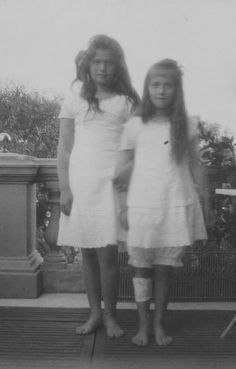 The Little Pair, Grand Duchess Marie (left) and Grand Duchess Anastasia.  With their barefeet, Marie's disheveled hair, and Anastasia's bandaged leg, you'd never guess they were daughters of one of the richest and most powerful men on earth.