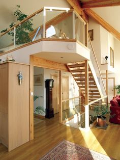 Contemporary railings with clear glass insets.