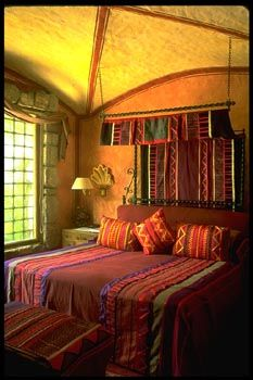 .Lovely warm colors of Mexican bedroom... Chris forget the colors.   I want the fan above the bed!!!