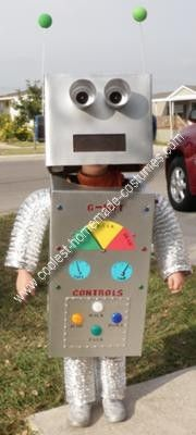 Homemade Robot Boy Costume: The body and head of this homemade robot boy costume are made from cardboard boxes then wrapped with art paper to make the silver chrome paint more metallic.